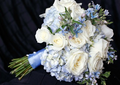 blue bouquet with white roses